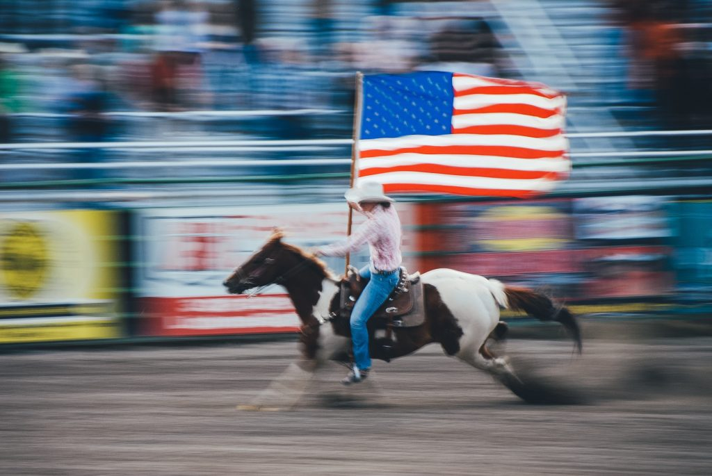 The US flag flown at a rodeo Grand Entry